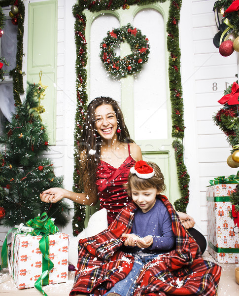 happy family on Christmas in red hats waiting gests and smiling Stock photo © iordani