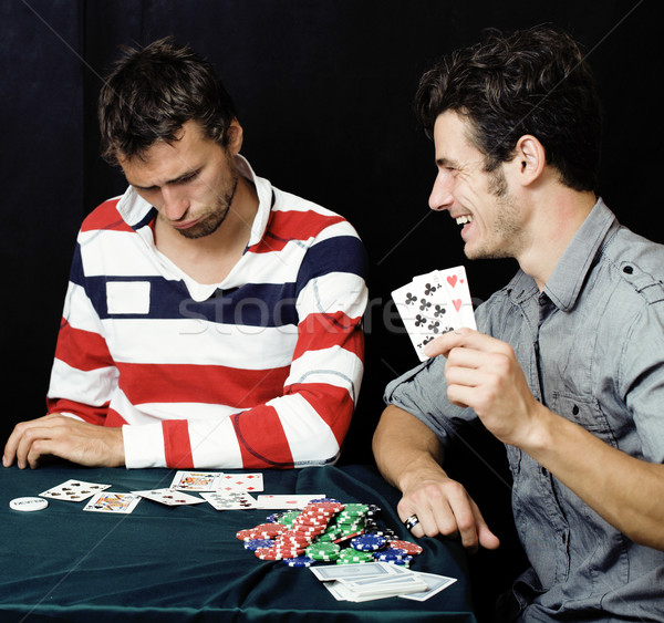 young people playing poker Stock photo © iordani