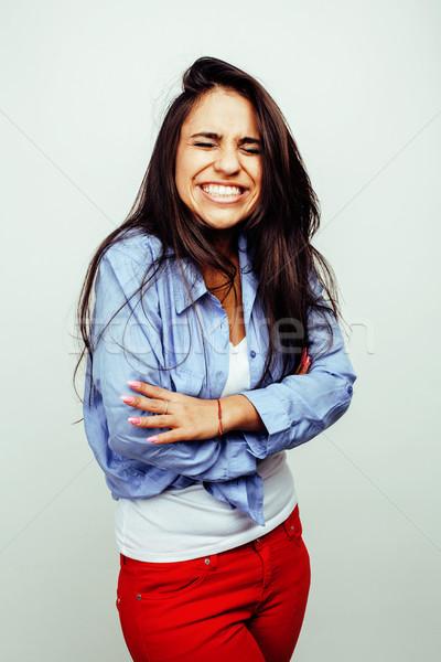 young happy smiling latin american teenage girl emotional posing on white background, lifestyle peop Stock photo © iordani