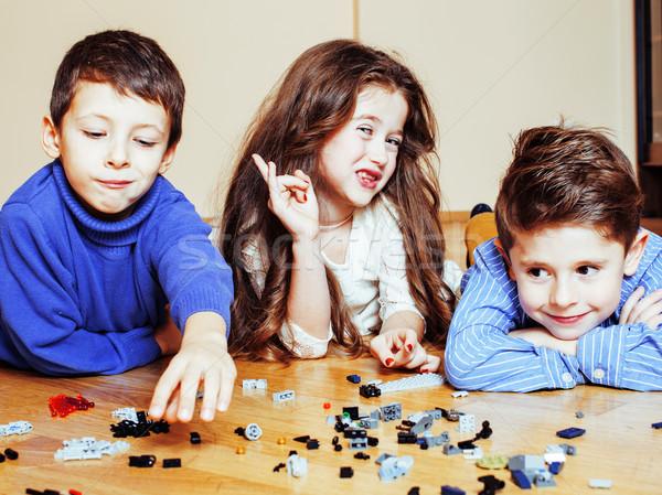 Vicces aranyos gyerekek játszik játékok otthon Stock fotó © iordani