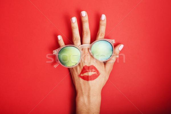Kadın el güneş gözlüğü parlak kozmetik Stok fotoğraf © iordani