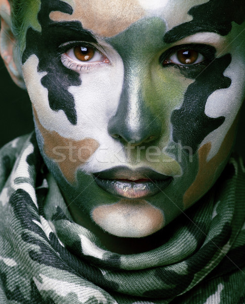 Beautiful young fashion woman with military style clothing and f Stock photo © iordani
