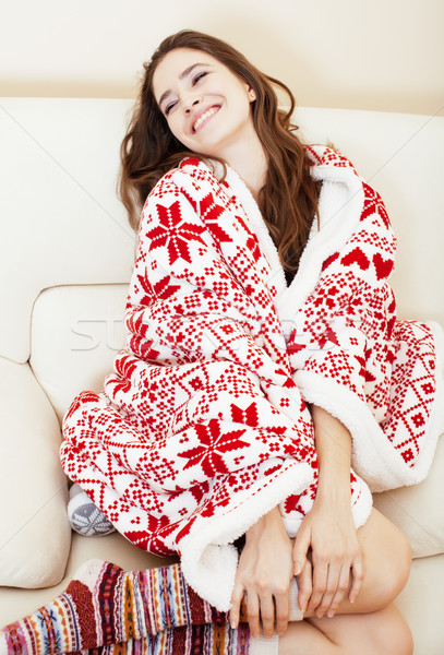 Stock photo: young pretty brunette girl in Christmas ornament blanket getting