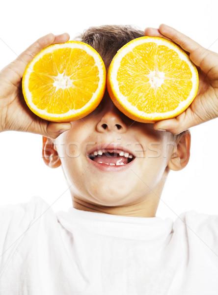Weinig cute jongen oranje vruchten verdubbelen geïsoleerd Stockfoto © iordani