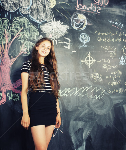 Stock photo: back to school after summer vacations, cute teen girl in classroom