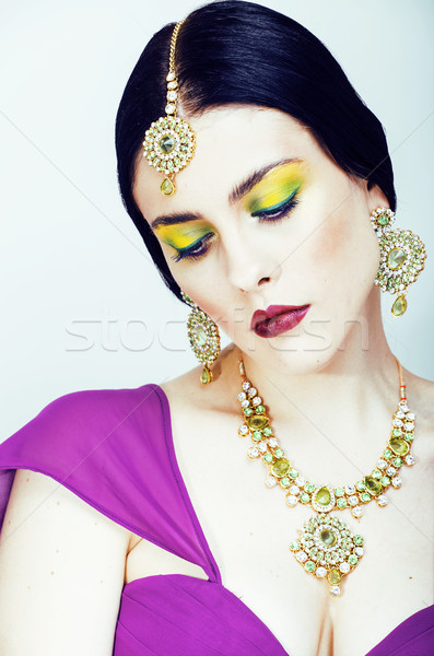 Stock photo: young pretty caucasian woman like indian in ethnic jewelry close up on white, bridal bright makeup