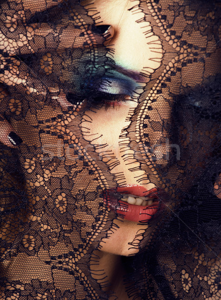 portrait of beauty young woman through lace Stock photo © iordani