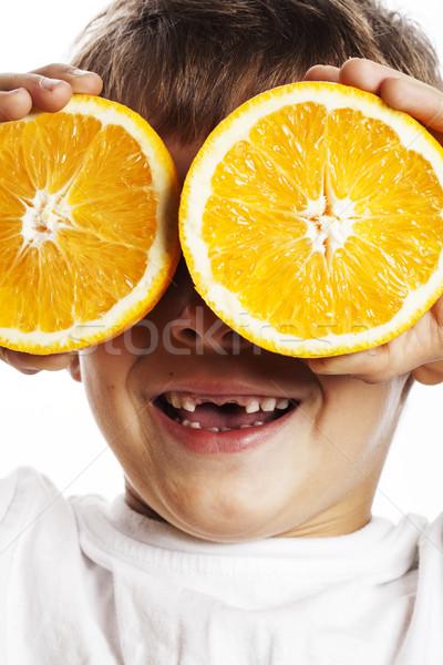 Pequeno bonitinho menino fruto de laranja dobrar isolado Foto stock © iordani