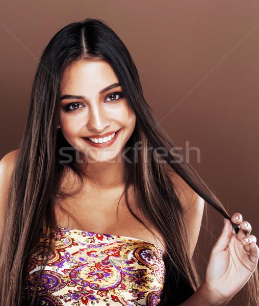 cute happy young indian woman in studio close up smiling, fashio Stock photo © iordani