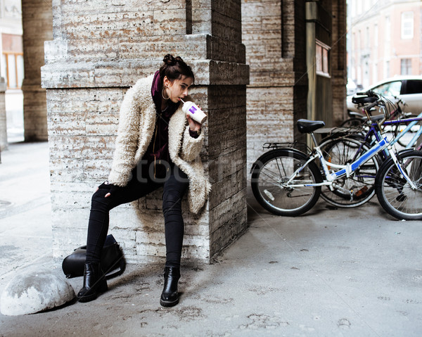 young pretty stylish teenage girl outside at city wall with graf Stock photo © iordani