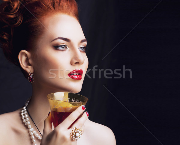 beauty stylish redhead woman with hairstyle and manicure wearing Stock photo © iordani