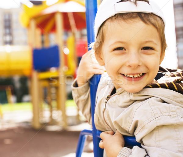 мало Cute мальчика Swing за пределами площадка Сток-фото © iordani