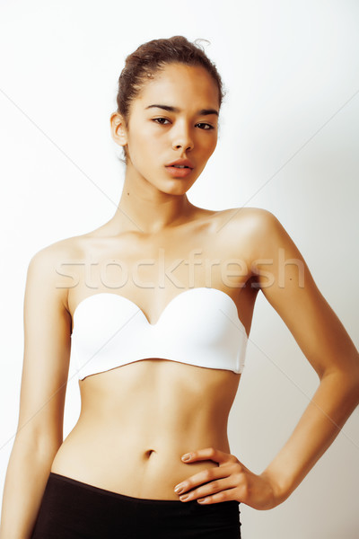 young pretty african american girl in sport underwear posing on white background, multi races woman  Stock photo © iordani