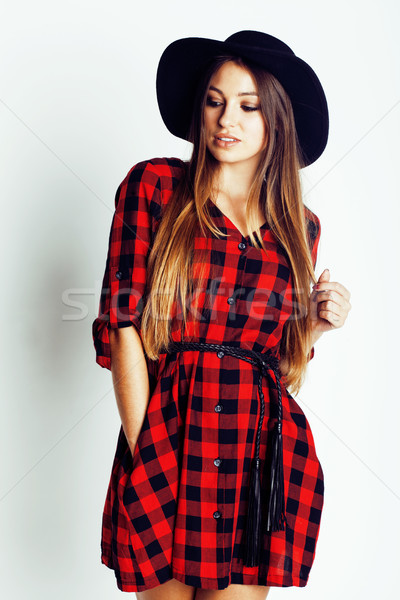 young pretty brunette girl hipster in hat on white background casual close up dreaming smiling. real Stock photo © iordani