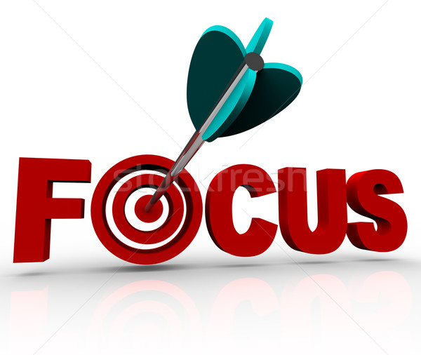 Focus Word with Arrow Hitting Target Bulls-Eye Stock photo © iqoncept