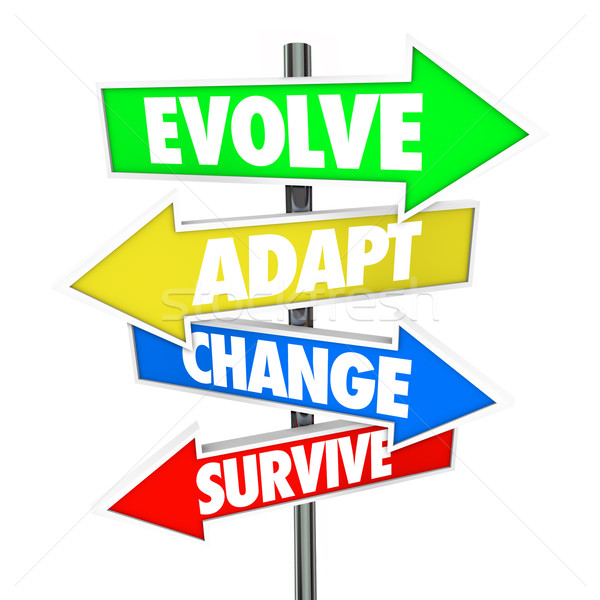 Stock photo: Evolve Adapt Change Survive Arrow Signs Evolution Adaptation Bus