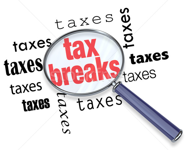 How to Find Tax Breaks - Magnifying Glass Stock photo © iqoncept
