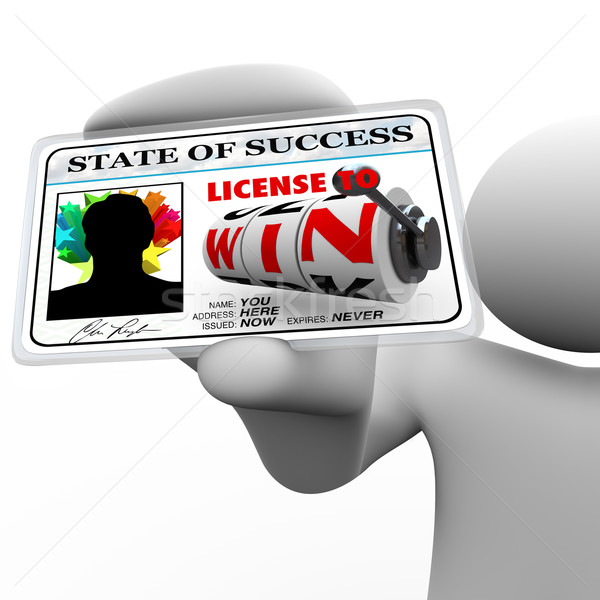 Man Holding License to Win as Identification Card for Access Stock photo © iqoncept