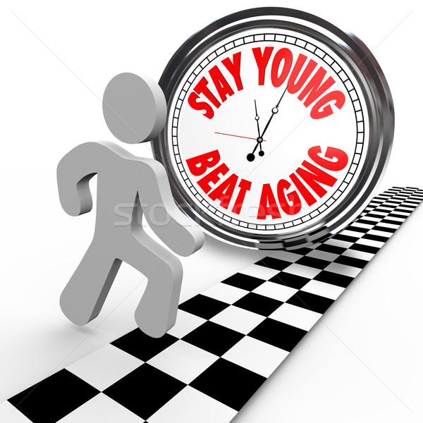 Stay Young Beat Aging Race Against Time Clock Stock photo © iqoncept