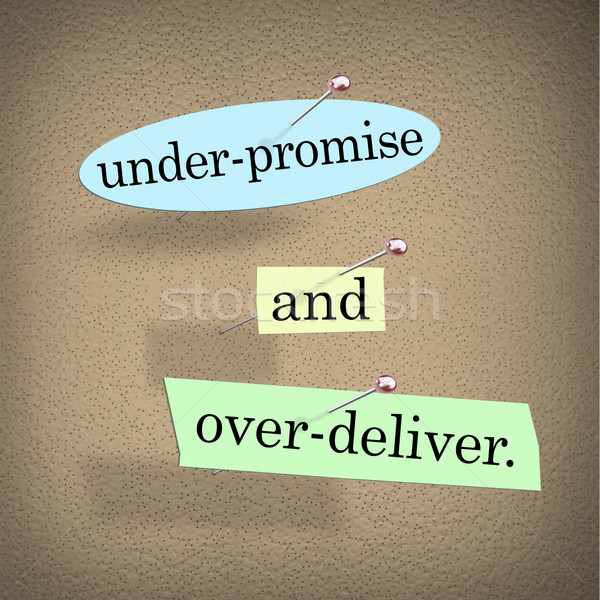 Under-Promise and Over-Deliver Saying Bulletin Board Stock photo © iqoncept