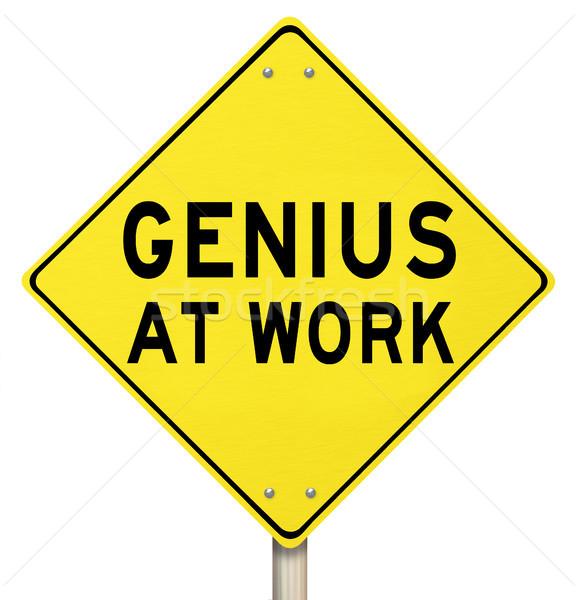 Gênio trabalhar amarelo placa sinalizadora aviso palavras Foto stock © iqoncept