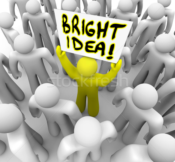 Bright Idea Person Holding Sign New Plan Suggestion Stock photo © iqoncept