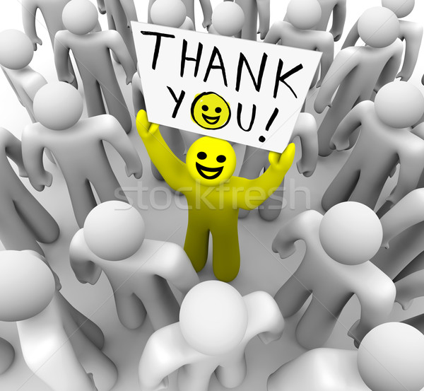 Smiley Face Person Holding Thank You Sign Stock photo © iqoncept