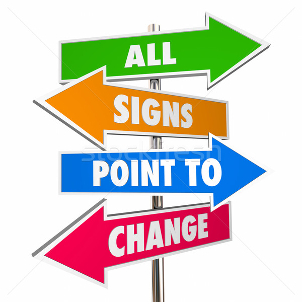 Stock photo: All Signs Point to Change Adapt Evolve Disrupt Signs 3D