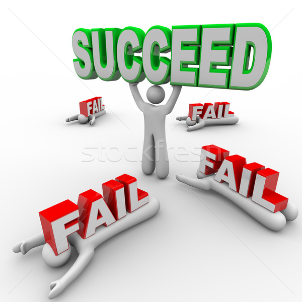 One Successful Person Holds Succeed Word Others Fail Stock photo © iqoncept