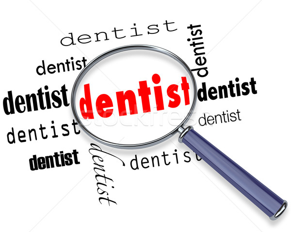 Finding a Dentist - Magnifying Glass Stock photo © iqoncept