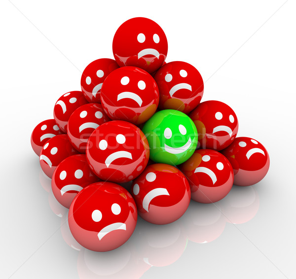 Happy Smile Face in Ball Pyramid of Sad Faces Stock photo © iqoncept