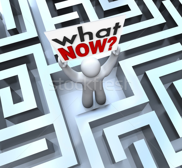 What Now Confused Person Holding Sign Lost in Maze Stock photo © iqoncept