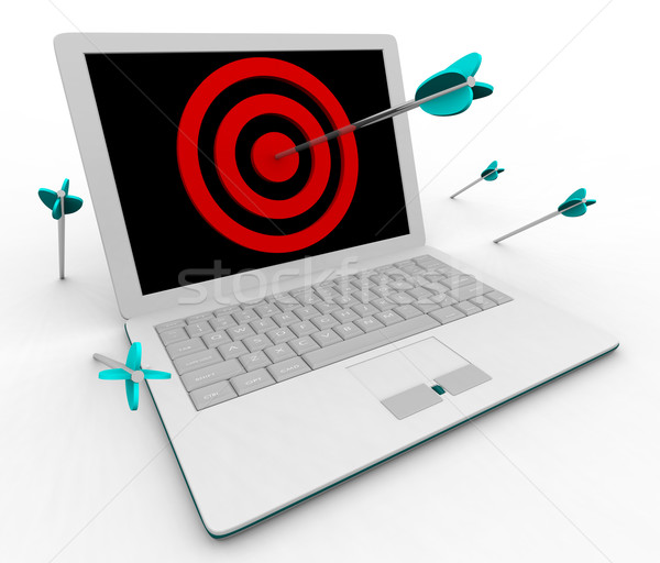 Hitting Bullseye on Computer Laptop Stock photo © iqoncept