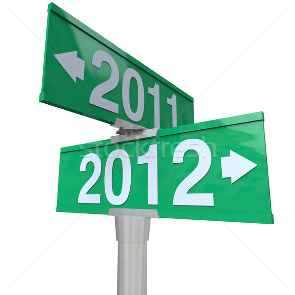 New Year 2012 Arrows Pointing from 2011 on  Two-Way Street Signs Stock photo © iqoncept