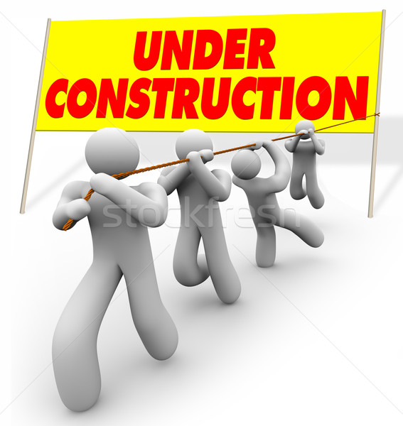 Under Construction - Team Pulling Up Sign Stock photo © iqoncept