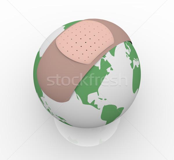 Bandage on Planet Earth Stock photo © iqoncept