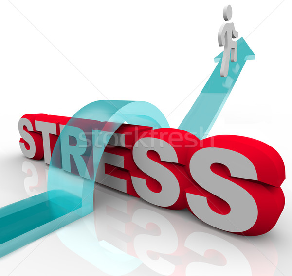 Overcoming Stress Beating Anxiety Jumping Over Word Stock photo © iqoncept