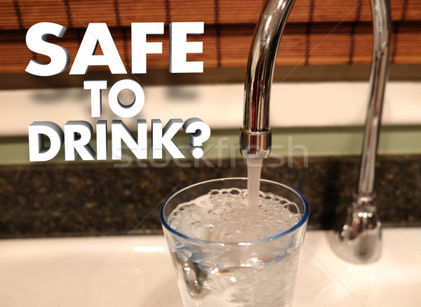 Safe to Drink Faucet Pouring Water in Glass Stock photo © iqoncept