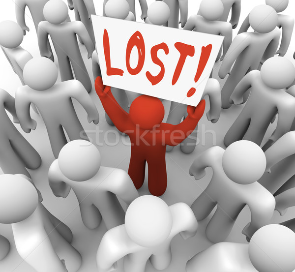 Person Holding Lost Sign in Crowd Stock photo © iqoncept