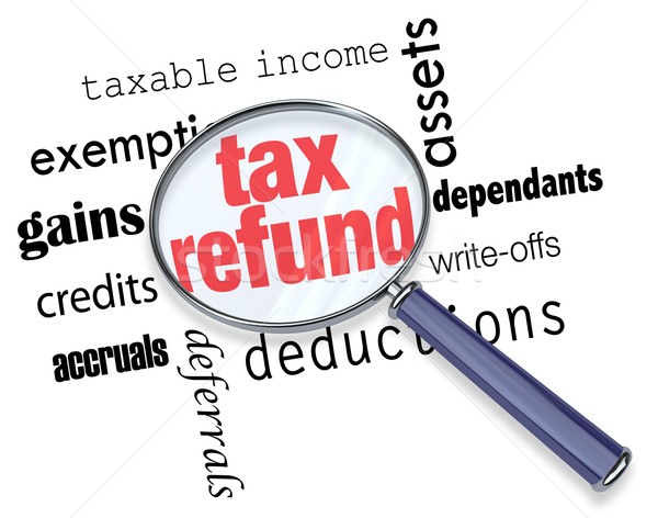 Searching for a Tax Refund - Magnifying Glass Stock photo © iqoncept
