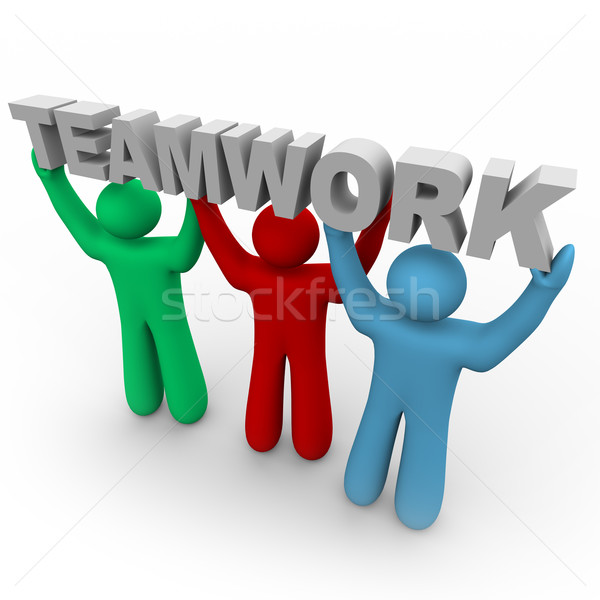 Teamwork - Three People Hold the Word Stock photo © iqoncept