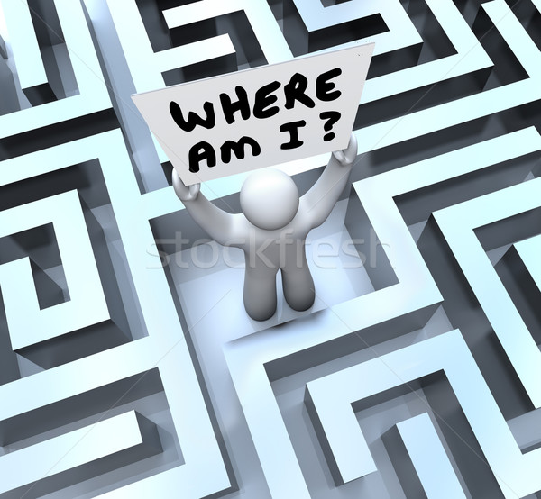 Where Am I Person Holding Sign Lost in Maze Stock photo © iqoncept