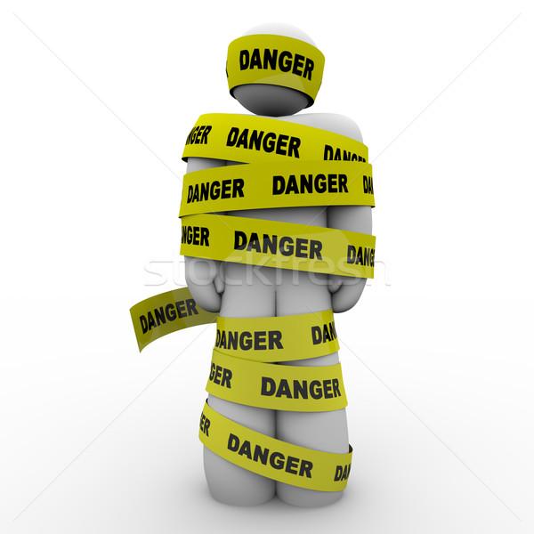 Személy citromsárga veszély szalag figyelmeztetés vigyázat Stock fotó © iqoncept