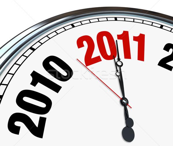 Clock conto alla rovescia capodanno 2011 mani Foto d'archivio © iqoncept