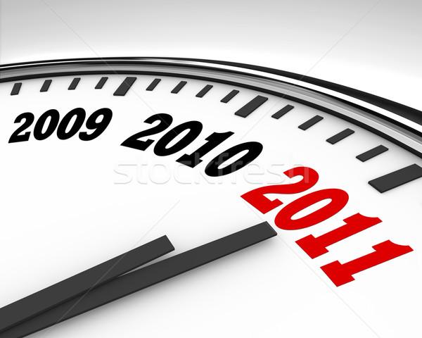 2011 clock conto alla rovescia capodanno bianco mani Foto d'archivio © iqoncept