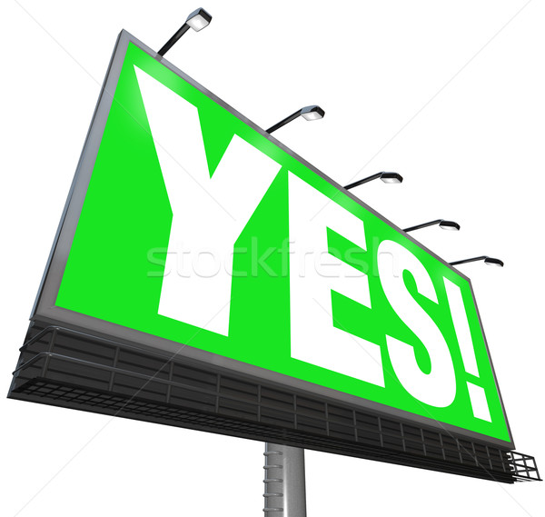 Oui mot Billboard vert signe approbation Photo stock © iqoncept
