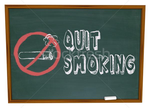 Quit Smoking - Cigarette on Chalkboard Stock photo © iqoncept