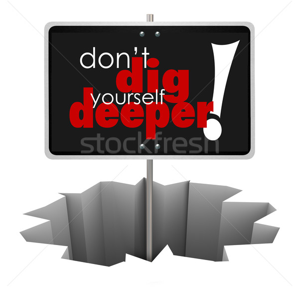 Don't Dig Yourself Deeper Sign Deeper SIgn in Hole Stock photo © iqoncept