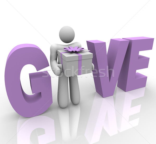 Give - Man in Word Holding Gift Stock photo © iqoncept