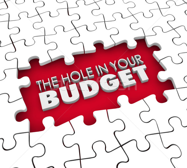 Hole in Your Budget Financial Shortfall Debt Bankruptcy Puzzle Stock photo © iqoncept
